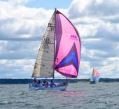 Sailboat race with colorful spinnakers — Stock Photo