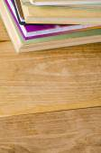 Stack of books on wooden table — Stock fotografie
