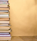 Stack of books on wooden table — Stock Photo