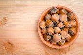 Heap of hazelnuts in bowl — Stock Photo