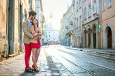 Couple posing on streets of Europe — Stock Photo