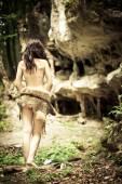 Brunette woman wearing a wolf skin — Stock Photo
