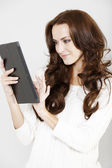 Woman using electronic tablet — Stock Photo