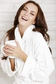 Woman in robe enjoying hot drink — Foto de Stock