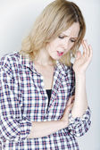 Woman looking pained — Stock Photo
