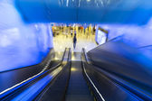 Motion down of escalator in department store — Stock Photo