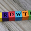 Word growth on wooden colorful cubes — Stock Photo #52171253