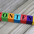 Word content on wooden cubes — Stock Photo #52481733