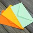 Colorful envelopes on wooden background — Stock Photo #52602193
