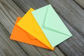 Colorful envelopes on wooden background — Stock Photo