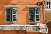 Wall of traditional greek house with window with wooden shutters — Stok fotoğraf
