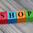 Concept of shop word on wooden colorful cubes — Stock Photo #56566187