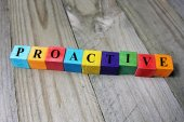 Concept of proactive word on wooden colorful cubes — Stock Photo