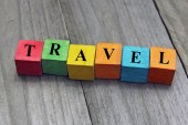 Concept of travel word on wooden colorful cubes — Stock Photo