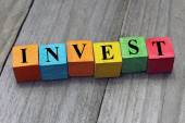 Concept of invest word on wooden colorful cubes — Stock Photo