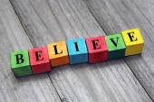 Believe word on colorful wooden cubes — Stock Photo