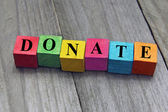 Concept of donation word on wooden cubes — Stock Photo