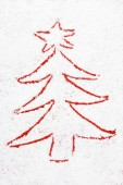 Red christmas tree drawn in the snow — Стоковое фото