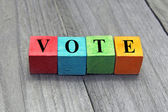 Concept of vote word on colorful wooden cubes — Stock Photo