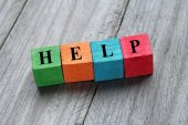 Concept of help on colorful wooden cubes — Stock Photo