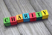 Concept of charity word on wooden cubes — Stock Photo