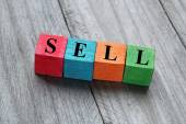 Sell concept on colorful wooden cubes — Stock Photo