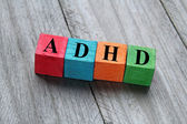 Concept of ADHD on colorful wooden cubes — Stock Photo