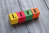 Palavra de vida em cubos de madeira — Fotografia Stock