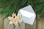 Christmas fir tree, silver envelope with gingerbread on wooden backgroun — ストック写真