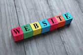 Word website on colorful wooden cubes — Stock Photo