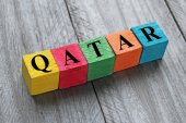 Word qatar on colorful wooden cubes — Stock Photo