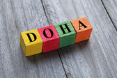 Word Doha on colorful wooden cubes — Stock Photo