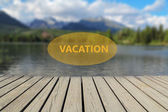 Concept of vacation, mountain lake in the background — Stock Photo