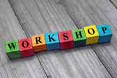 Word workshop on colorful wooden cubes — Stock Photo