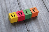 Word golf on colorful wooden cubes — Stock Photo
