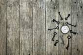 Decorative composition with old pocket watch and rusty keys. — Stock Photo