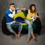 Couple watching football — Stock Photo #52832363