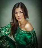 Green arab dress for nice model — Stock Photo