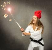 Sushi chef cutting with katana — Stock Photo