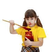 Menina com pote de geléia — Fotografia Stock