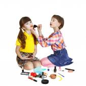 Cute girls play makeup — Stock Photo