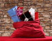 Gifts in sack — Stock Photo
