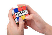 Hand playing Square puzzle to be OMG the well known expression o — Stock Photo