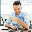 Man browsing internet on tablet — Stock Photo #68813835