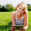 Young woman using a tablet — Stock Photo #68814349