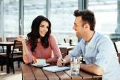 Couple discussing and writing down ideas — Stock Photo