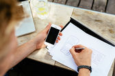 Man drawing blueprint of mobile application — Stock Photo
