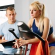 Personal trainer and young woman — Stock fotografie #68852807