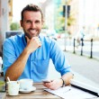 Young man at outdoor cafe — Stock Photo #68855655