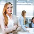 Female manager standing in office — Stock Photo #68859325